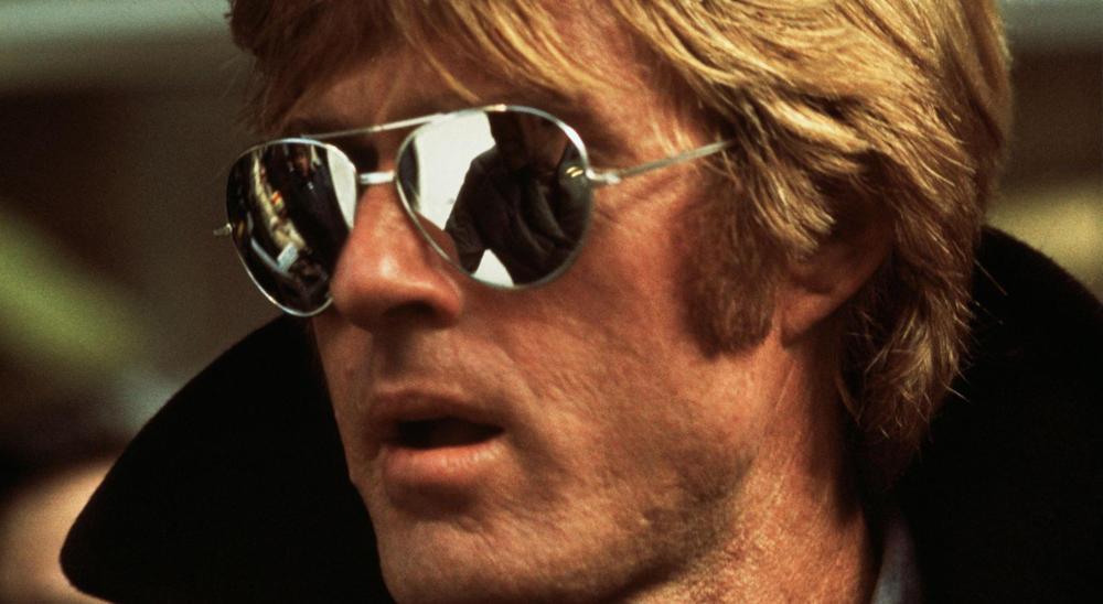 Robert Redfor usando gafas de sol tipo Aviador con cristales de espejo